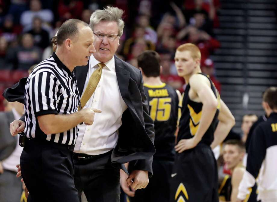 Iowa coach Fran McCaffery, second from left, argues a call during the second half of an NCAA college basketball game against Wisconsin, Sunday, Jan. 5, 2014, in Madison, Wis. McCaffery was ejected from the game and Iowa was charged with two technical fouls. Wisconsin won 75-71. (AP Photo/Andy Manis) ORG XMIT: WIAM108 Photo: Andy Manis / FR19153 AP