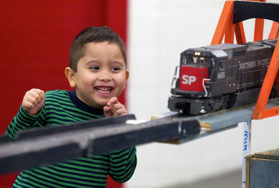 Liam Busby, 5, is all smiles as a model Southern Pacific Railroad engine drives by during the World's Greatest Hobby on Tour at the George R. Brown Convention Center on Saturday, Jan. 11, 2014, in Houston.  The tour occupies over 100,000 square feet with 200 booths, hobby shops, and train layouts for train enthusiast to enjoy. Photo: J. Patric Schneider, For The Chronicle / © 2014 Houston Chronicle