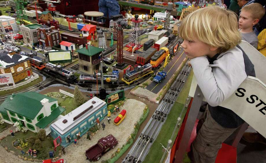 Aiden Torstric, 5, watch as a model railroad engine passes by during the World's Greatest Hobby on Tour at the George R. Brown Convention Center on Saturday, Jan. 11, 2014, in Houston. Photo: J. Patric Schneider, For The Chronicle / © 2014 Houston Chronicle