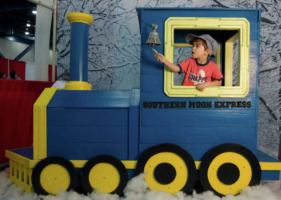 Calvin Meaux, 3, rings the bell on a toy train during the World's Greatest Hobby on Tour at the George R. Brown Convention Center on Saturday, Jan. 11, 2014, in Houston. Photo: J. Patric Schneider, For The Chronicle / © 2014 Houston Chronicle