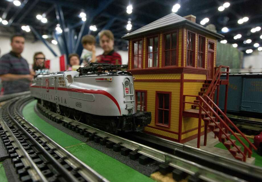 Railroad enthusiast watch as a model railroad engine passes by during the World's Greatest Hobby on Tour at the George R. Brown Convention Center on Saturday, Jan. 11, 2014, in Houston. Photo: J. Patric Schneider, For The Chronicle / © 2014 Houston Chronicle