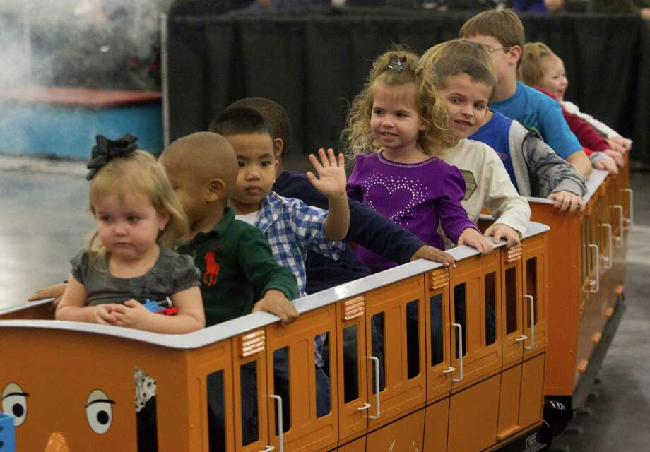 Children enjoy riding Thomas the Tank Engine during the World's Greatest Hobby on Tour at the George R. Brown Convention Center on Saturday, Jan. 11, 2014, in Houston. Photo: J. Patric Schneider, For The Chronicle / © 2014 Houston Chronicle