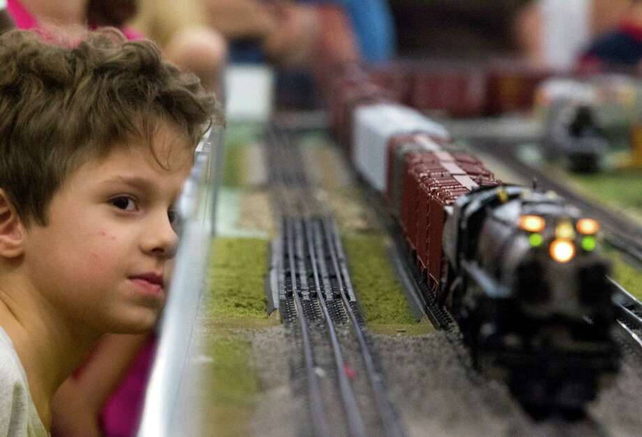 Jake McLeod, 7, watches as a model railroad engine drives by during the World's Greatest Hobby on Tour at the George R. Brown Convention Center on Saturday, Jan. 11, 2014, in Houston. Photo: J. Patric Schneider, For The Chronicle / © 2014 Houston Chronicle