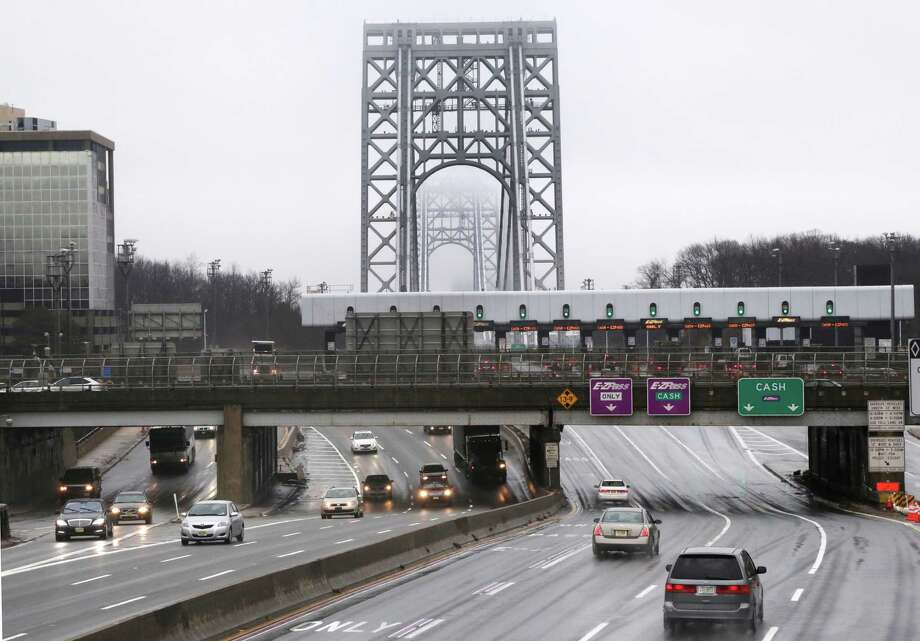 Traffic approaches the toll booths at the George Washington Bridge, in Fort Lee, N.J., Saturday, Jan. 11, 2014. The September lane closings near the George Washington Bridge that caused huge traffic jams and now threaten the rise of Republican star Chris Christie violated federal law, a chief official said in an email ordering the lanes reopened.   The Sept. 13 email was among thousands of pages released Friday by a New Jersey legislative committee investigating the scandal, which could haunt Christie's expected run for president in 2016. The documents mostly involve the Port Authority of New York and New Jersey, the agency that runs the heavily trafficked bridge. (AP Photo/Richard Drew) ORG XMIT: NJRD103 Photo: Richard Drew / AP
