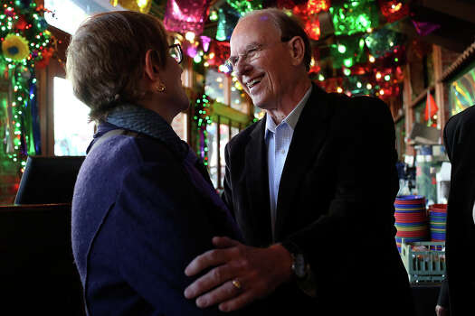 Bexar County Judge Nelson Wolff greets visitors arriving at the official kick-off event for his re-election campaign at Mi Tierra Cafe in San Antonio on Saturday, Jan. 11, 2014. Photo: Lisa Krantz, San Antonio Express-News / San Antonio Express-News