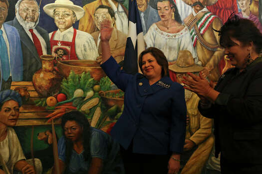 State Senator and candidate for Lieutenant Governor Leticia Van de Putte waves to the crowd as she is announced before speaking in support of Bexar County Judge Nelson Wolff as Wolff officially kicks off his re-election campaign at Mi Tierra Cafe in San Antonio on Saturday, Jan. 11, 2014. After speaking, Van de Putte left for her own campaign event in the Texas panhandle. Photo: Lisa Krantz, San Antonio Express-News / San Antonio Express-News
