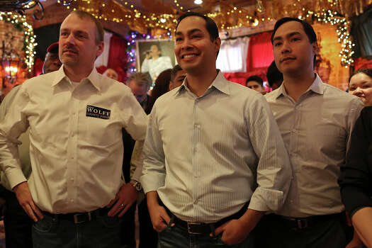 Christian Archer, campaign manager for Bexar County Judge Nelson Wolff, from left, stands with Mayor Julian Castro and Congressman Joaquin Castro as they watch County Commissioner Paul Elizondo speak during the official kick off of Wolff's re-election campaign at Mi Tierra Cafe in San Antonio on Saturday, Jan. 11, 2014. Photo: Lisa Krantz, San Antonio Express-News / San Antonio Express-News