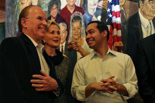 Bexar County Judge Nelson Wolff stands with his wife, Tracy Wolff, and Mayor Julian Castro after Wolff officially announced his re-election campaign at Mi Tierra Cafe in San Antonio on Saturday, Jan. 11, 2014. Photo: Lisa Krantz, San Antonio Express-News / San Antonio Express-News