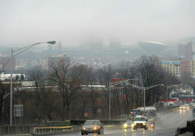 The Empire State Plaza top levels are obscured by fog on Saturday Jan. 11, 2014 as seen from Rensselaer, N.Y.  (Michael P. Farrell/Times Union) Photo: Michael P. Farrell / 00025324A