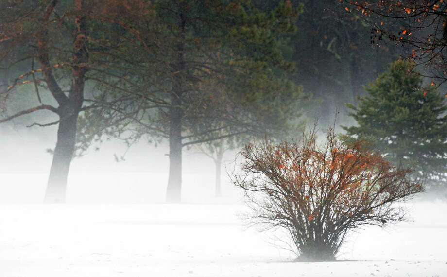 A ground fog rolls over the Barney Road Golf Course Saturday Jan. 11, 2014, in Clifton Park, NY.  (John Carl D'Annibale / Times Union) Photo: John Carl D'Annibale / 00025324A