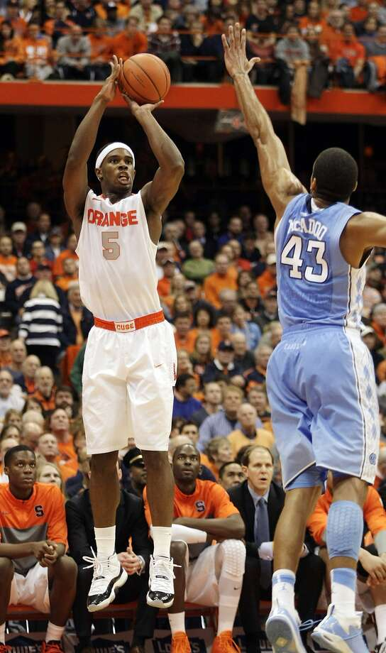 Syracuse's C.J. Fair shoots over North Carolina's James Michael McAdoo on his way to 20 points. Photo: Nick Lisi, Associated Press