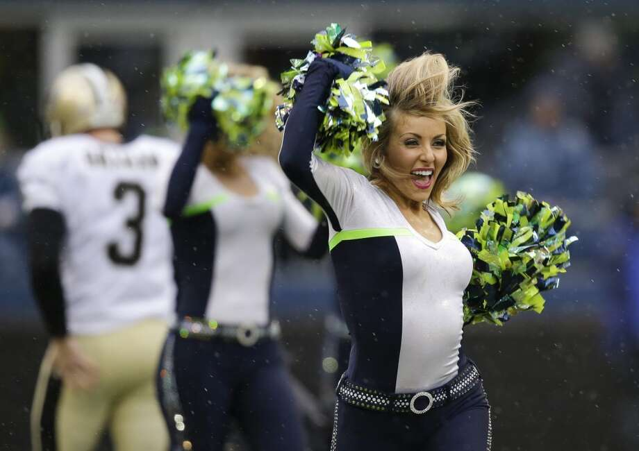 Sea Gals Zoe performs before the NFC divisional playoff against the New Orleans Saints in Seattle, on Jan. 11, 2014. (AP Photo/Elaine Thompson) Photo: ASSOCIATED PRESS
