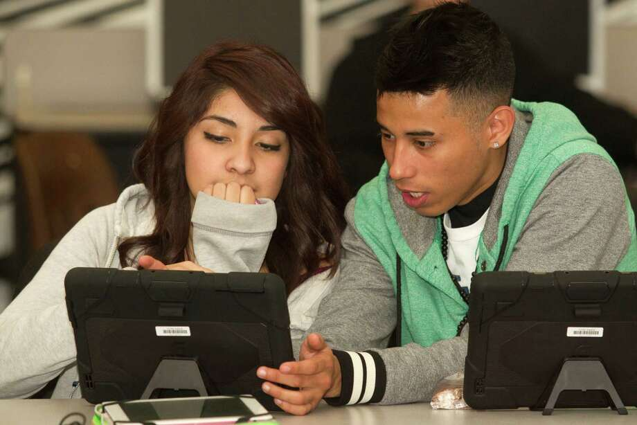 Clear Creek ISD (bond approved in May 2013)Bond amount: $367 millionTax increase: YesPictured: Clear Brook High School sophomores Karen Gonzalez and Bryan Davila work with their new Dell Latitude 10 tablet computer from Clear Creek ISD on Jan. 8, 2014, in Friendswood. Photo: J. Patric Schneider, For The Chronicle / © 2014 Houston Chronicle