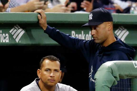 FILE - In this Sept. 13, 2013 file photo, New York Yankees' Alex Rodriguez sits in the dugout as Derek Jeter stands next to him during the first inning of a baseball game against the Boston Red Sox at Fenway Park in Boston.  Rodriguez's drug suspension has been cut to 162 games from 211 by arbitrator Fredric Horowitz, a decision sidelining the New York Yankees third baseman the entire 2014 season.  (AP Photo/Elise Amendola)