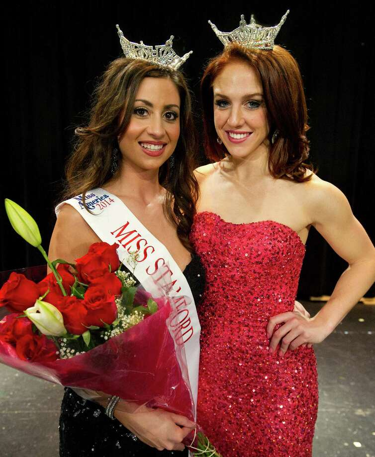 Cara Ann Cama, 22, of New Haven, poses for a photo with Kaitlyn Tarpey, Miss Connecticut 2013,  after winning the first Miss Stamford competition at the Rogers International School in Stamford, Conn., on January 11, 2014. Cama won the competition. Photo: Lindsay Perry / Stamford Advocate