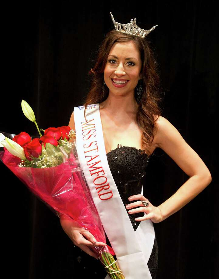 Cara Ann Cama, 22, of New Haven, poses for a photo with her sash and crown after winning the first Miss Stamford competition at the Rogers International School in Stamford, Conn., on January 11, 2014. Cama won the competition. Photo: Lindsay Perry / Stamford Advocate