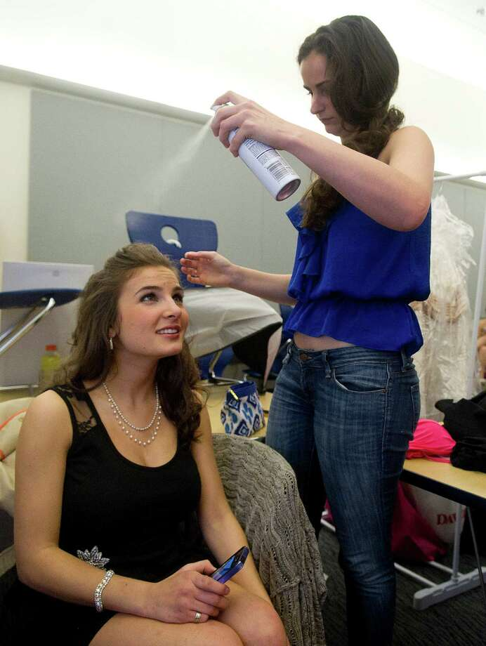 Jessica Palmiotto, 18, of Ridgefield, prepares to go on stage during the first Miss Stamford competition at the Rogers International School in Stamford, Conn., on January 11, 2014. Photo: Lindsay Perry / Stamford Advocate