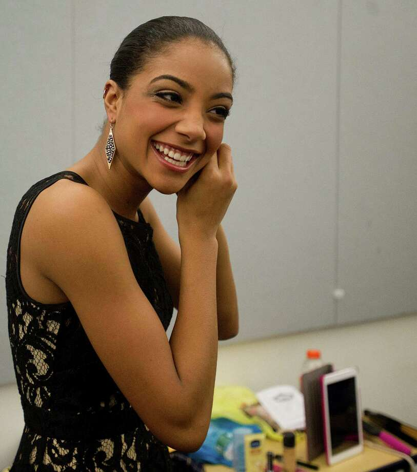Miss Connecticut's Outstanding Teen 2013, Tiana Dyson, prepares to help emcee for the first Miss Stamford competition at the Rogers International School in Stamford, Conn., on January 11, 2014. Photo: Lindsay Perry / Stamford Advocate