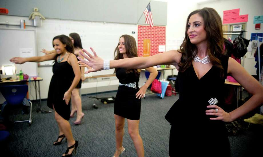 Contestants practice the opening number backstage as they prepare to go on stage during the first Miss Stamford competition at the Rogers International School in Stamford, Conn., on January 11, 2014. Photo: Lindsay Perry / Stamford Advocate