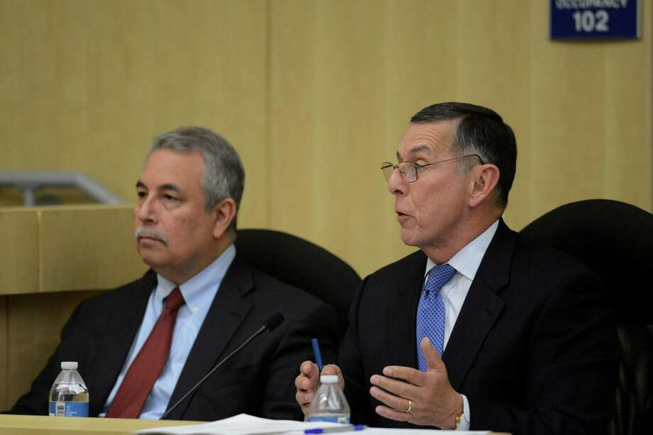 South San ISD's interim superintendent Abelardo Saavedra, right, attends a meeting on Thursday, Jan. 9, 2014. Attorney Pablo Escamilla sits at left. Photo: Billy Calzada, San Antonio Express-News / San Antonio Express-News