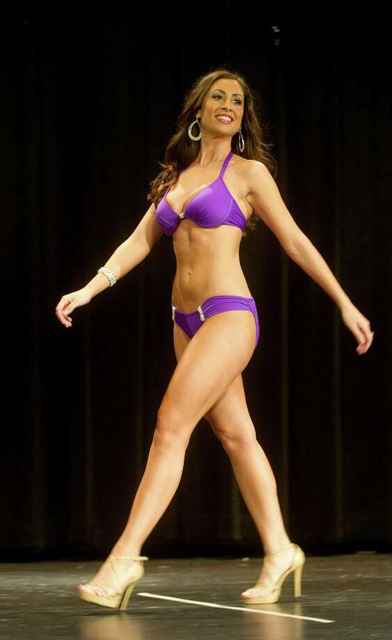 Cara Ann Cama, 22, of New Haven, competes in the lifestyle and fitness portion during the first Miss Stamford competition at the Rogers International School in Stamford, Conn., on January 11, 2014. Photo: Lindsay Perry / Stamford Advocate