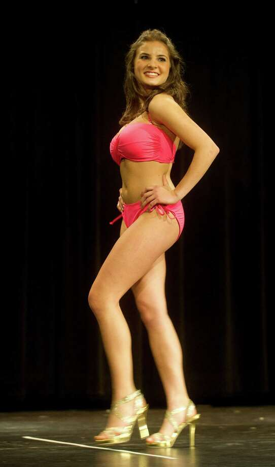Jessica Palmiotto, 18, of Ridgefield, competes in the lifestyle and fitness portion during the first Miss Stamford competition at the Rogers International School in Stamford, Conn., on January 11, 2014. Photo: Lindsay Perry / Stamford Advocate
