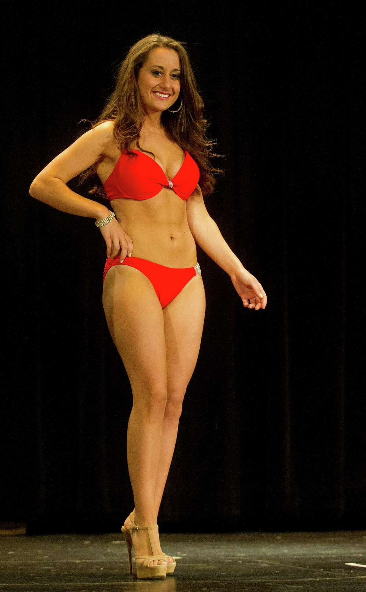 Natascia Simone, 20, competes in the lifestyle and fitness portion during the first Miss Stamford competition at the Rogers International School in Stamford, Conn., on January 11, 2014.
