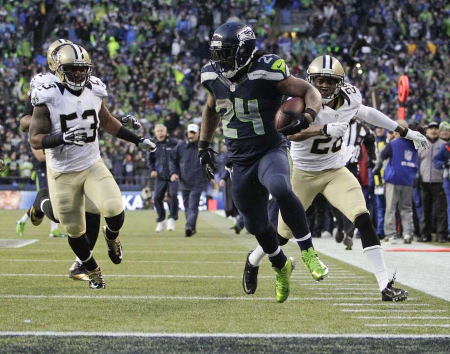 Division Round Jan. 11: Seahawks 23, Saints 15  Seahawks running back Marshawn Lynch (24) runs past Saints cornerback Keenan Lewis (28) and outside linebacker Ramon Humber (53) to score a 31-yard touchdown. Photo: John Froschauer, Associated Press