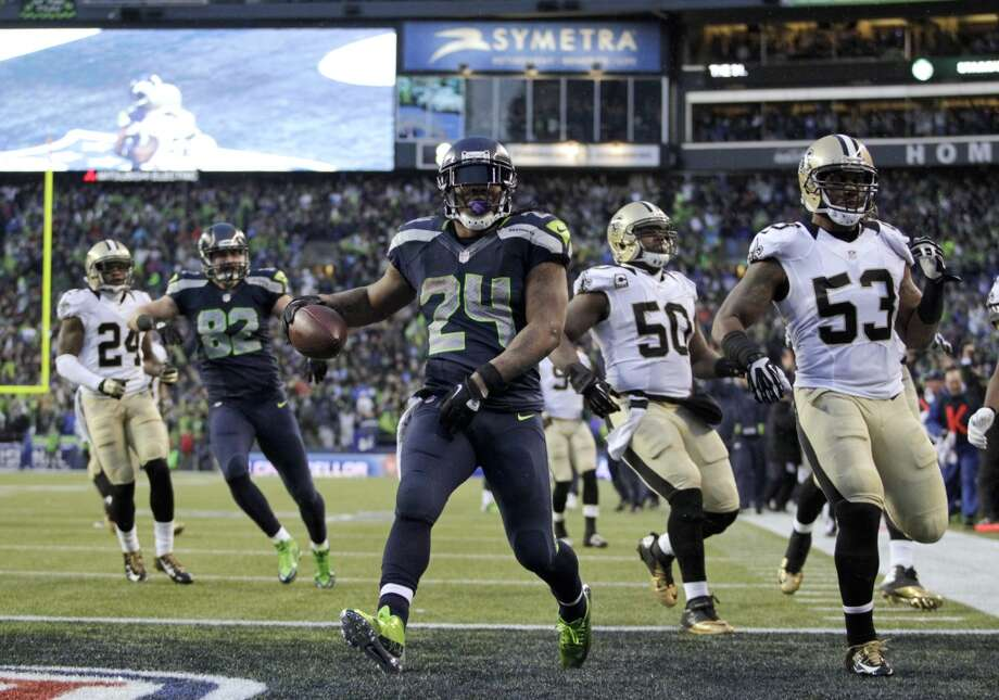 Seahawks running back Marshawn Lynch (24) arrives in the end zone after a 31-yard touchdown run. Photo: John Froschauer, Associated Press