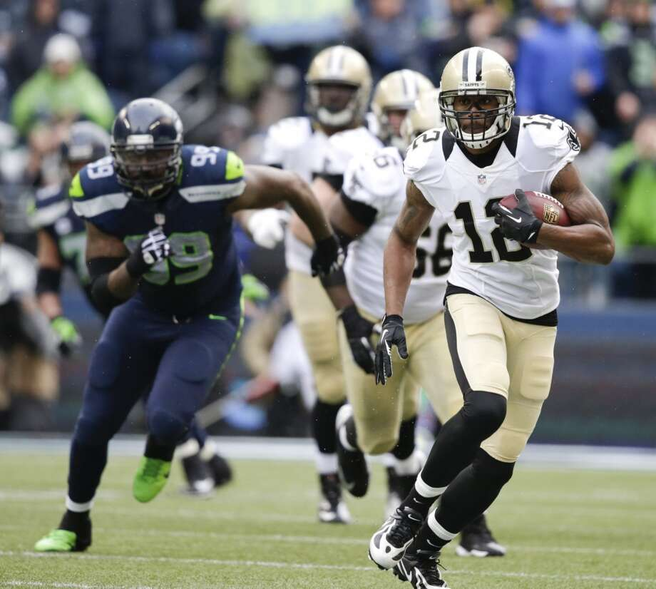 Saints wide receiver Marques Colston, right, runs after a catch. Photo: John Froschauer, Associated Press