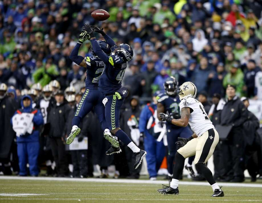 Cornerback Byron Maxwell #41 and free safety Earl Thomas #29 of the Seahawks are unable to make an interception as the ball is caught by wide receiver Robert Meachem #17 of the Saints. Photo: Otto Greule Jr, Getty Images