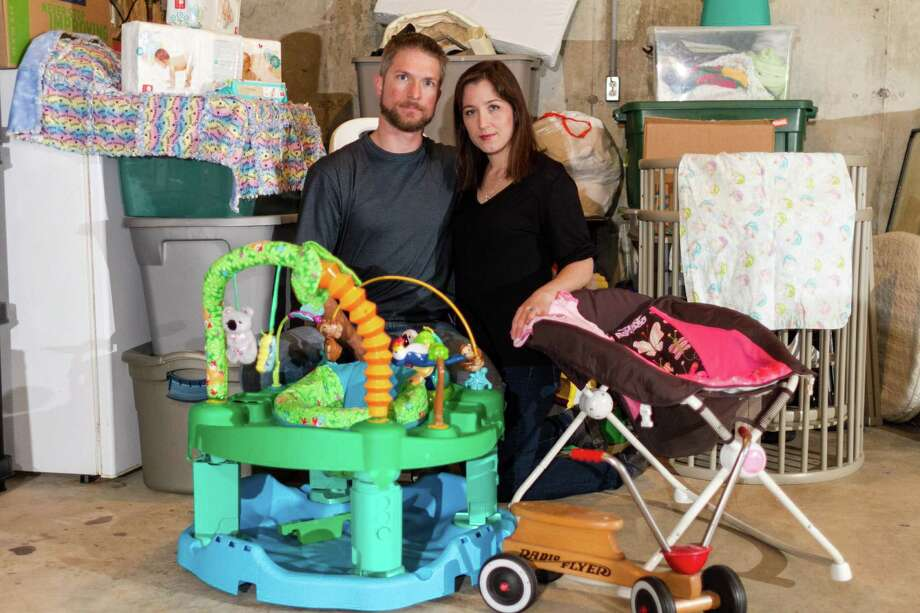 Jason and Annise Neidrich, of Rolla, Mo., say they were duped into believing they would be adoptive parents. Instead, the baby items they acquired in preparation are now stored in a relative's basement. Photo: Roger Vaughn, Photographer / © Roger Vaughn Photography, LLC