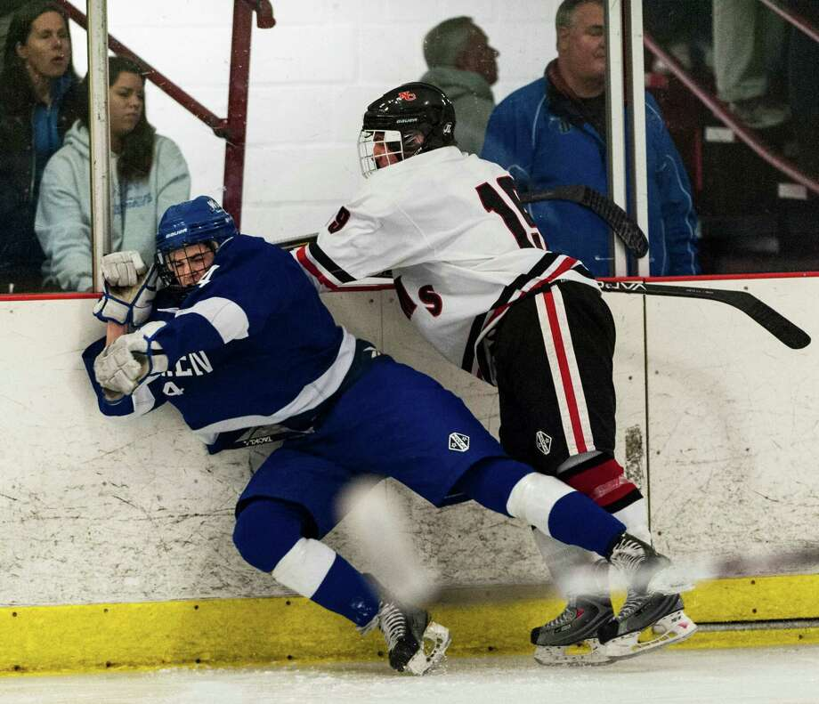 New Canaan high school against Darien high school during a boys ice hockey game played at Darien Ice Rink, Darien CT on Saturday, January, 11th, 2014. Photo: Mark Conrad / Connecticut Post Freelance