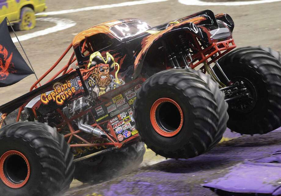 Captain's Curse, driven by Alex Blackwell, prepares to jump cars in the opening round of the Monster Jam trucks competition in the Alamodome on Saturday, Jan. 11, 2014. Photo: Billy Calzada, San Antonio Express-News / San Antonio Express-News