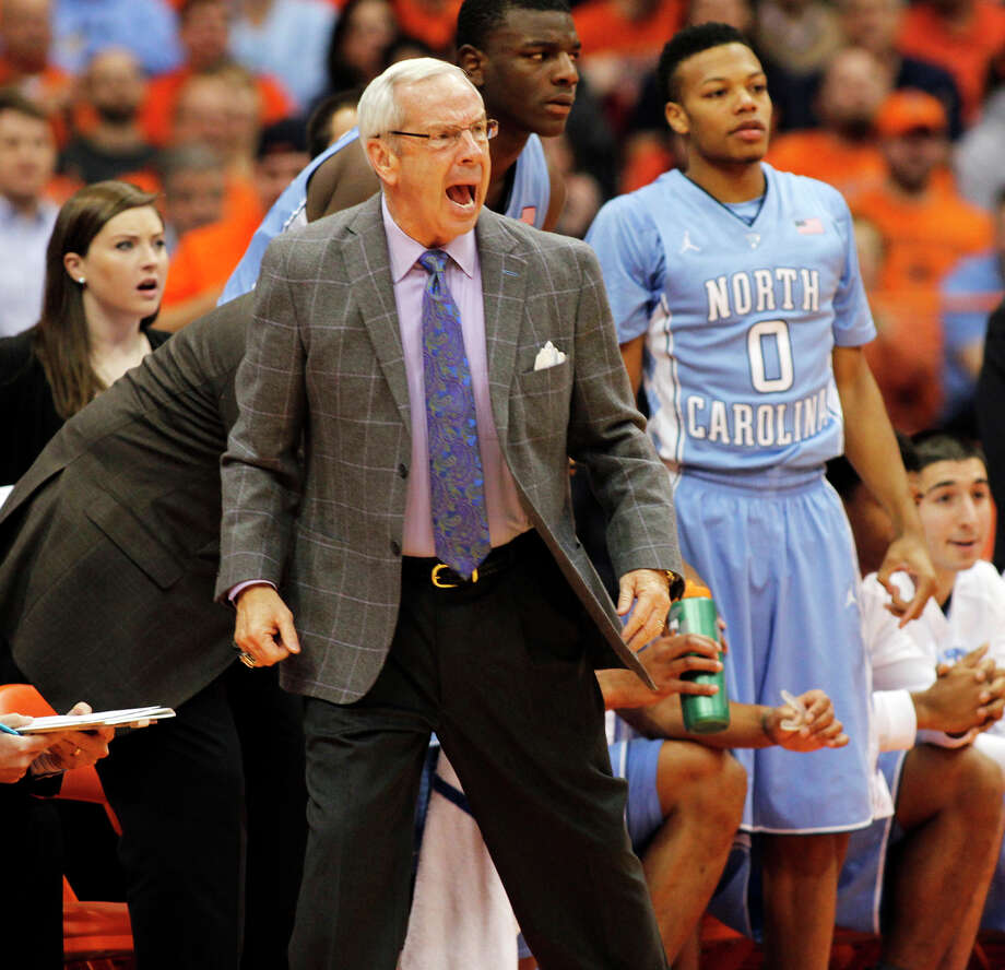 North Carolina's head coach Roy Williams, center, yells to his players in the first half of an NCAA college basketball game against Syracuse in Syracuse, N.Y., Saturday, Jan. 11, 2014. (AP Photo/Nick Lisi) ORG XMIT: NYNL103 Photo: Nick Lisi / FR171024 AP