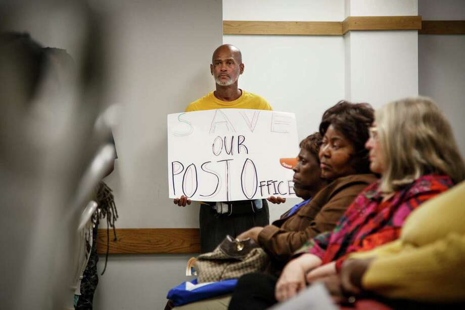 Robin St. Cyr calls for the Southmore Station post office to stay open at a town hall meeting Saturday. Photo: Michael Paulsen, Staff / © 2014 Houston Chronicle