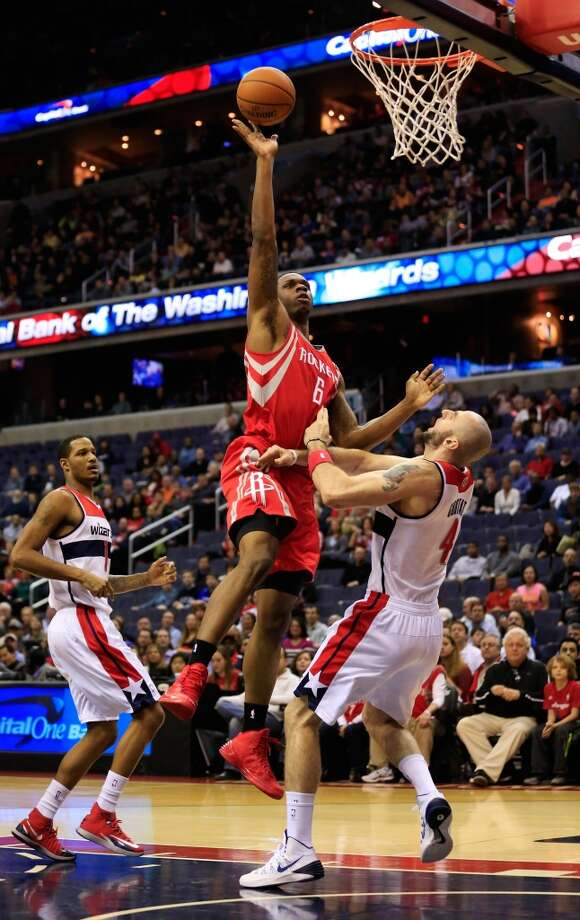 Terrence Jones #6 of the Rockets puts up a shot over Marcin Gortat. Photo: Rob Carr, Getty Images