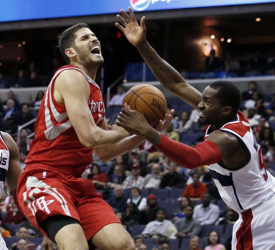 Rockets forward Omri Casspi (18), from Israel, is fouled by Wizards forward Martell Webster. Photo: Alex Brandon, Associated Press
