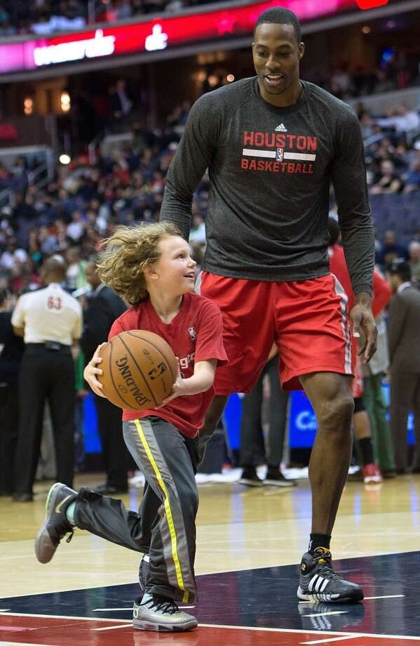 During a stoppage in play due to water leaking from the roof of the Verizon Center in the first half, Dwight Howard plays one-on-one with Sandro Dussel, age 10 from McClain, Va. Photo: Harry E. Walker, McClatchy-Tribune News Service