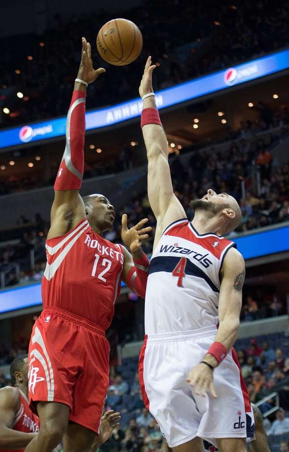 Rockets power forward Dwight Howard (12) shoots over Wizards center Marcin Gortat. Photo: Harry E. Walker, McClatchy-Tribune News Service