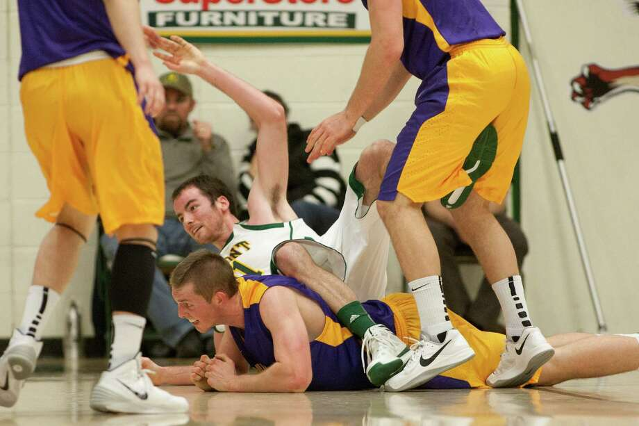 Luke Devlin of UAlbany and Clancy Rugg of Vermont get tangled up during the Great Danes 68-38 defeat against the Catamounts at Patrick Gymnasium in Burlington, VT on January 11, 2014 (Shane Bufano/For The Times Union) Photo: Shane Bufano