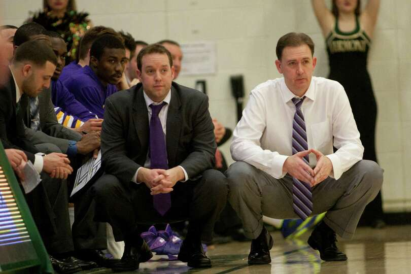 UAlbany coaches Jeremy Friel (left) and Will Brown (right) look disappointed as the Catamounts exten