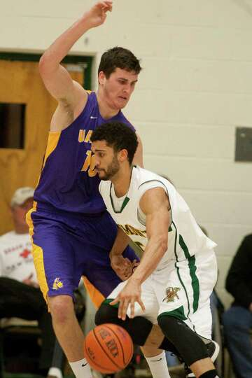 Mike Rowley (10) of UAlbany defends Vermont's Hector Harold down in the block during the Great Danes