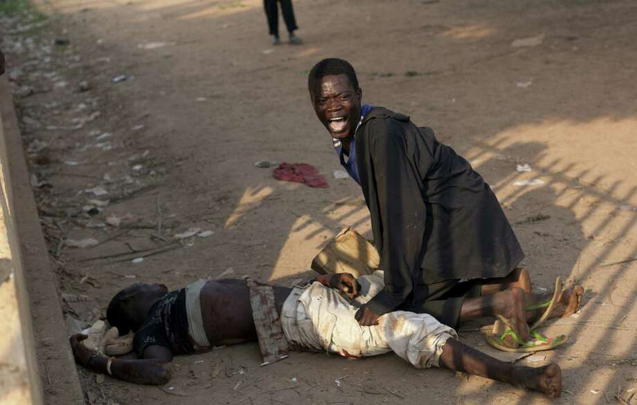A young man cries for a friend injured by Chadian troops during a protest in Bangui, Central African Republic, on Dec. 23. Photo: Rebecca Blackwell, Associated Press / AP