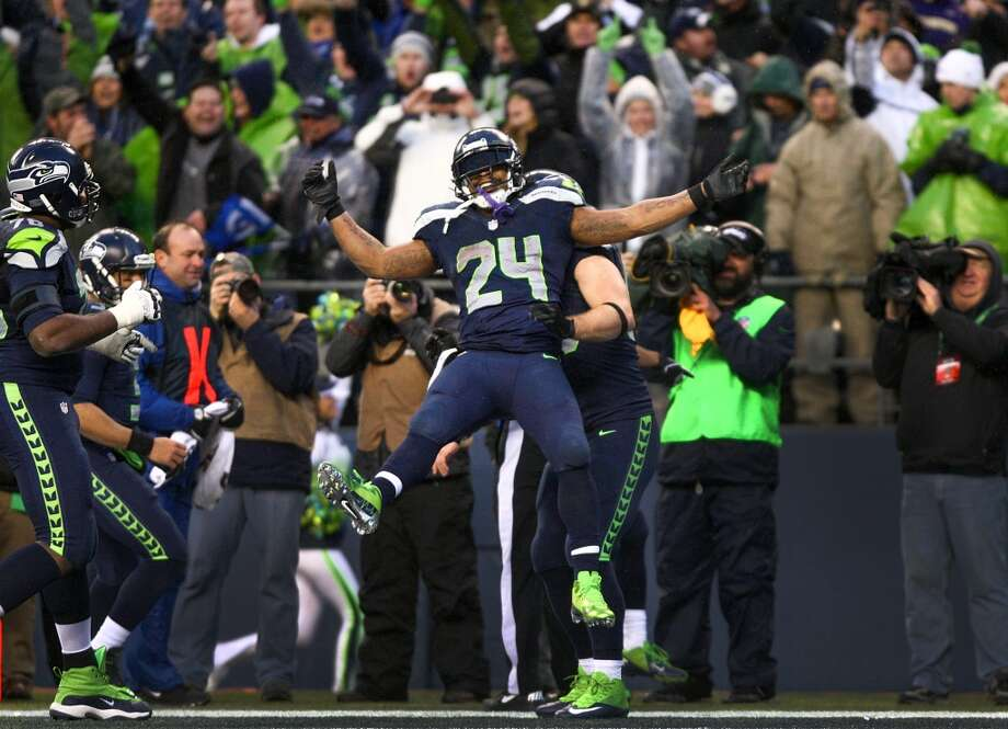 Seattle Seahawks player Marshawn Lynch is lifted in the air by teammates after scoring the game clinching touchdown against the New Orleans Saints during the second half of an NFC Divisional Playoff game on Saturday, January 11, 2014 at CenturyLink Field in Seattle. Photo: JOSHUA TRUJILLO, SEATTLEPI.COM