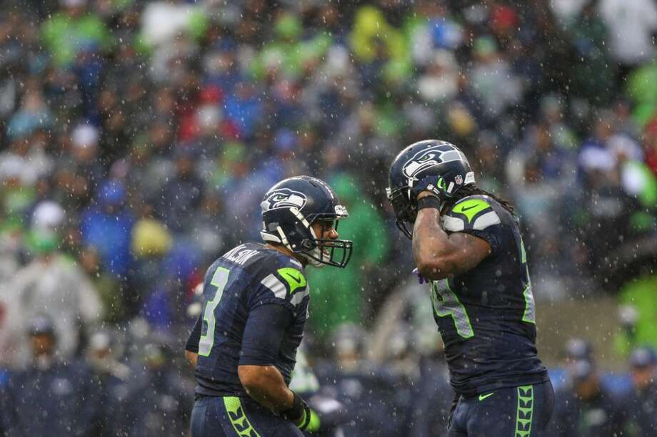 Seattle Seahawks quarterback Russell Wilson yells to teammate Marshawn Lynch as they play the New Orleans Saints during the NFC Divisional Playoff game on Saturday, January 11, 2014 at CenturyLink Field in Seattle. Photo: JOSHUA TRUJILLO, SEATTLEPI.COM