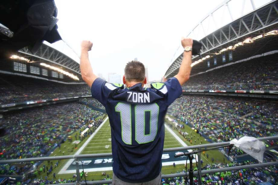 Former Seattle Seahawks quarterback Jim Zorn throws up his arms after raising the 12th Man flag during the NFC Divisional Playof game against the New Orleans Saints on Saturday, January 11, 2014 at CenturyLink Field in Seattle. Photo: JOSHUA TRUJILLO, SEATTLEPI.COM