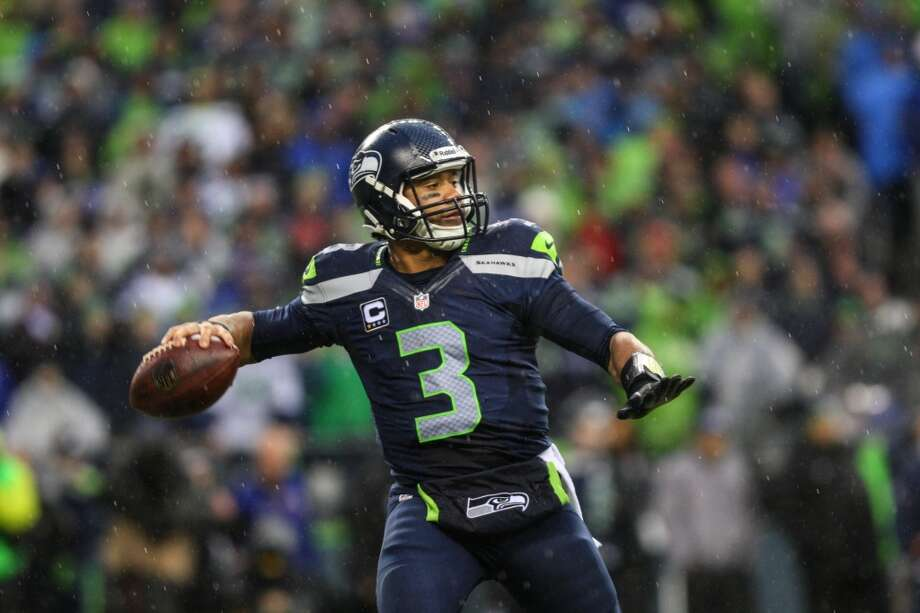 Seattle Seahawks quarterback Russell Wilson throws against the New Orleans Saints during the second half of an NFC Divisional Playoff game on Saturday, January 11, 2014 at CenturyLink Field in Seattle. Photo: JOSHUA TRUJILLO, SEATTLEPI.COM