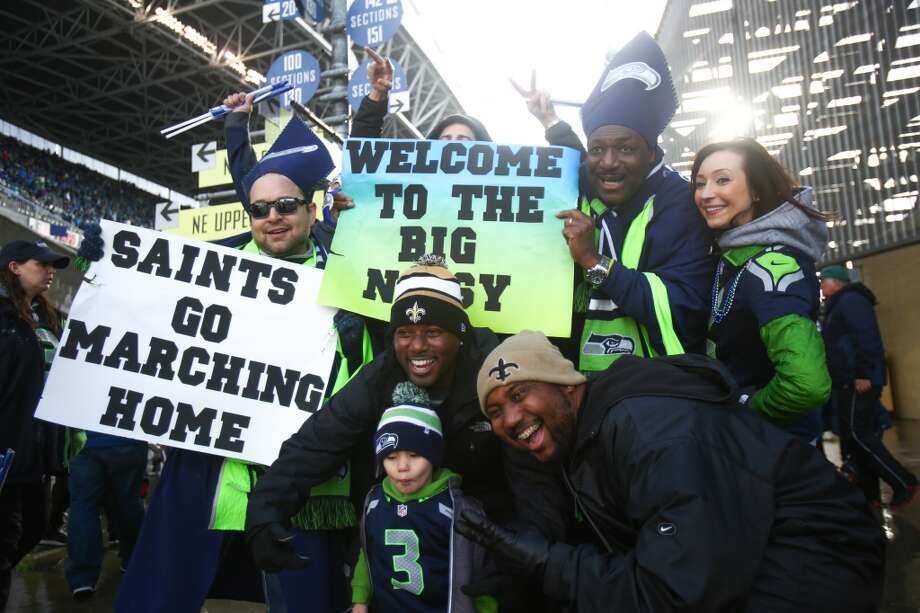 Seattle Seahawks fans and New Orleans Saints fans pose for a photo during the NFC Divisional Playoff game on Saturday, January 11, 2014 at CenturyLink Field in Seattle. Photo: JOSHUA TRUJILLO, SEATTLEPI.COM