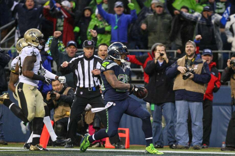 Seattle Seahawks player Marshawn Lynch crosses into the end zone for a game clinching touchdown against the New Orleans Saints on Saturday, January 11, 2014 at CenturyLink Field in Seattle. Photo: JOSHUA TRUJILLO, SEATTLEPI.COM